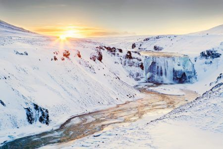 Sunrise over frozen waterfall in Iceland. Taken on the Game of thrones location tour