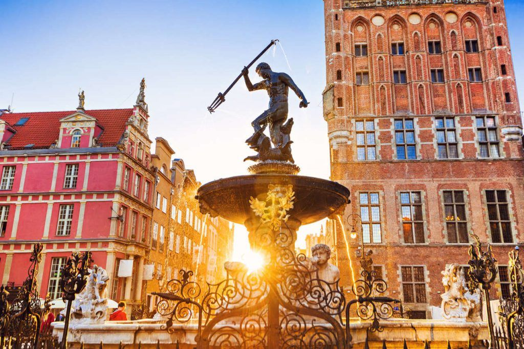 Poland, Gdansk, Famous Neptune fountain at sunset. Popular tourist attraction and travel destination in Europe